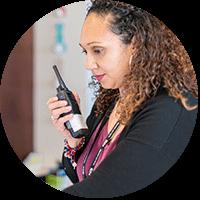 Faculty using Motorola Solutions Two way radio