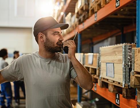 Warehouse worker on a Motorola two-way radio